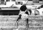 RRwalking_down_steps_in_handstand_splits.jpg
