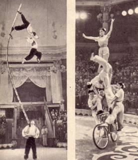 группa гимнастов на мачтах